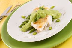 Cod with asparagus Stock Images