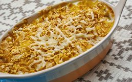 Cod Au Gratin. Appetizer from New Foundland, Canada, Flaked cod is layered with white sauce, and sprinkled with Cheddar cheese before being baked in this stock images