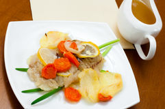 Cod baked with vegetables Stock Image