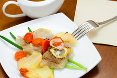 Cod baked with vegetables Royalty Free Stock Images