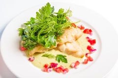Cod baked in white wine cream sauce, cheese and Stock Photo
