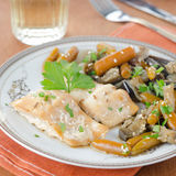 Cod in beer marinade with vegetables Stock Photos