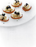 Cod with caviar on steamed poatatoes Royalty Free Stock Image