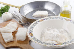 Cod filet in flour placed Royalty Free Stock Photos