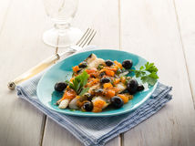 Cod fillet with black olives Stock Photography