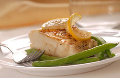 Cod fillet with green beans Royalty Free Stock Photo