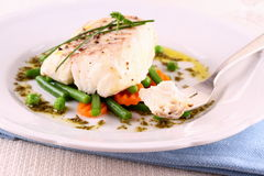 Cod Fillet with green beans, peas, parsley Stock Photography