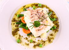 Cod Fillet with green beans, peas, parsley Royalty Free Stock Images