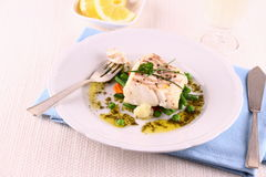 Cod fillet with green beans, peas, parsley, olive oil, wine Royalty Free Stock Photo
