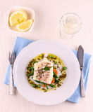 Cod Fillet with green beans, peas, parsley, wine Stock Photos