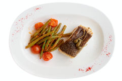 Cod fillet with runner beans isolated on white background Royalty Free Stock Image