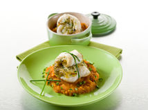 Cod fillet stuffed with herbs Stock Photos