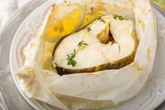 Free Cod Fillets  Baked In Parchment Paper With Slices Stock Photo - 50114050