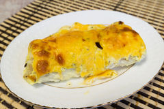 Cod fillets with cheese sauce on  plate Stock Photo