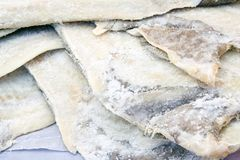 Cod fish. A pile of dry salted cod Stock Photos