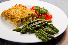 Cod fish with crispy breadcrumbs and asparagus Royalty Free Stock Photos