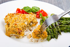 Cod fish with crispy breadcrumbs and asparagus Stock Photos