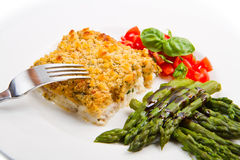 Cod fish with crispy breadcrumbs and asparagus Royalty Free Stock Images