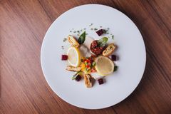 Cod fish fillet pan baked in lemon with cos, beet root, string bean, potato and champagne white wine sauce