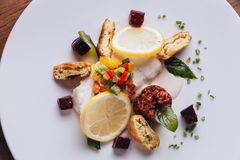 Cod fish fillet pan baked in lemon with cos, beet root, string bean, potato and champagne white wine sauce.