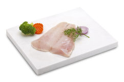 Cod fish fillet. Raw cod fish fillet on a white marble(path included Royalty Free Stock Photo