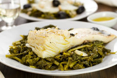 Cod fish with greens Stock Photos