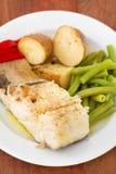 Cod fish with potato Stock Photos