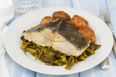 Cod fish with potato and vegetables on white plate Royalty Free Stock Photos