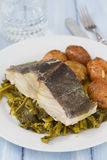 Cod fish with potato and vegetables on white plate Stock Photography