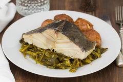 Cod fish with potato and vegetables Stock Photography
