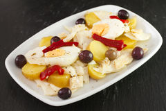 Cod fish salad with olives Stock Photography