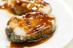 Cod fish with sauce Royalty Free Stock Images