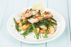 Cod fish steak with potato and green beans. Grilled cod fish steak with green beans and potato Royalty Free Stock Photography