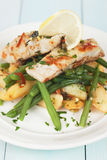 Cod fish steak with potato and green beans Royalty Free Stock Images
