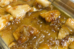 Cod with honey. Caramelized cod with honey sauce Stock Photography