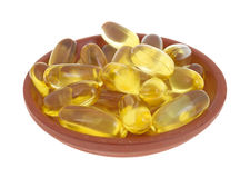 Cod Liver Oil Capsules In Small Dish Royalty Free Stock Photography