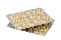 Cod liver oil capsules on white background Royalty Free Stock Photo