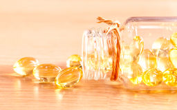 Cod liver oil capsules  . Royalty Free Stock Photos