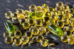 Cod liver oil, food supplement, fish oil capsules for everyday healthy nutrition and life energy stock photography