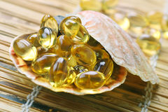 Cod liver oil gelatin capsules Royalty Free Stock Photos