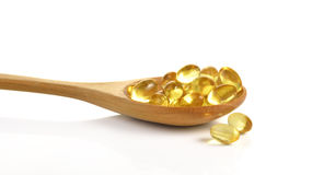 Cod liver oil omega 3 gel capsules isolated on white background. Royalty Free Stock Photos