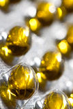 Cod liver oil omega 3 gel capsules  on pastel background. Vitamin d pils Stock Photos