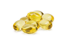 Cod liver oil omega 3 gel capsules or pils isolated on a white background. A group of transparent fish oil tablets. Fish oil capsules with omega 3 and vitamin D Stock Images