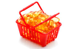 Cod liver oil Omega 3 in the shopping basket Royalty Free Stock Photos