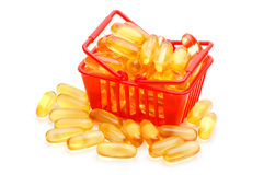 Cod liver oil Omega 3 in the shopping basket Royalty Free Stock Photography