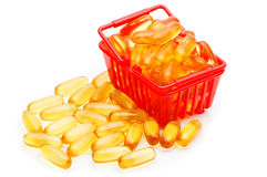 Cod liver oil Omega 3 in the shopping basket Royalty Free Stock Image