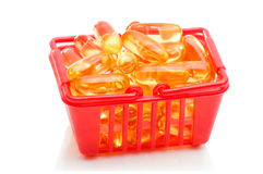 Cod liver oil Omega 3 in the shopping basket Royalty Free Stock Images