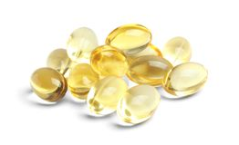 Cod liver oil pills. On white background royalty free stock photography