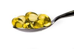 Cod Liver Oil Tablets. Spoonful of Cod Liver Oil Tablets Royalty Free Stock Photography