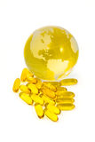 Cod Liver Oil and world globe Royalty Free Stock Photos